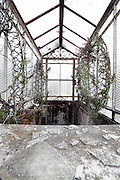 abandoned flower wreath in a dilapidated glasshouse tomb