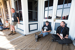 Cannonballers Jeff Erdman (L) and Jon Dobbs after a great hosted dinner in historic downtown Dodge City, KS during the Motorcycle Cannonball Race of the Century. Stage-8 from Wichita, KS to Dodge City, KS. USA. Saturday September 17, 2016. Photography ©2016 Michael Lichter.