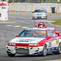 John Wholagan (35 - Nissan Skyline R32 GT-R) leading Terry Smith (18 - Hooper) into Turn 1 at Wanneroo Raceway