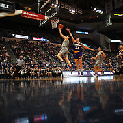HARTFORD, CONNECTICUT- JANUARY 4: A general view as Kia Nurse #11 of the Connecticut Huskies drive to the basket for two points past Kristen Gaffney #24 of the East Carolina Lady Pirates during the UConn Huskies Vs East Carolina Pirates, NCAA Women's Basketball game on January 4th, 2017 at the XL Center, Hartford, Connecticut. (Photo by Tim Clayton/Corbis via Getty Images)