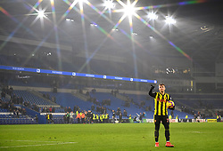 Watford's Gerard Deulofeu celebrates with the match ball after scoring a hat trick after the final whistle during the Premier League match at the Cardiff City Stadium.