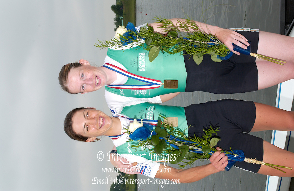 Poznan, POLAND.  2006, FISA, Rowing World Cup the IRL LW2X  right Niamh NI CHEILLEACHAIR and Sinead JENNINGS,  Bronze medallist on the awards dock.at the  'Malta Regatta course;  Poznan POLAND, Sat. 17.06.2006. © Peter Spurrier   ....[Mandatory Credit Peter Spurrier/ Intersport Images] Rowing Course:Malta Rowing Course, Poznan, POLAND