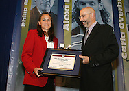 28 August 2006: Carla Overbeck (l) is presented with her Hall of Fame jacket, plaque, and ring by HOF president Will Lunn during her induction. The National Soccer Hall of Fame Induction Ceremony was held at the National Soccer Hall of Fame in Oneonta, New York.
