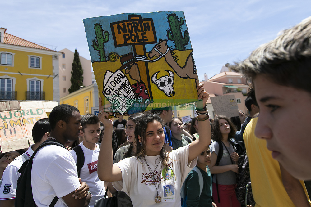 """May 24, 2019 - Lisbon, Lisbon, Portugal - A student is seen holding a placard in front of the Portuguese parliament, during the protest..Thousands of Portuguese students joined the international movement """"Fridays for Future"""" in Lisbon to protest against the climate situation. This strike aims to alert political leaders worldwide to the seriousness of climate problems. (Credit Image: © Hugo Amaral/SOPA Images via ZUMA Wire)"""