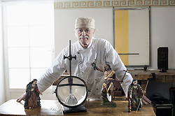 Senior sculptor making religious sculptures at workshop, Bavaria, Germany