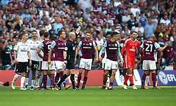 Aston Villa's Jack Grealish is shown a yellow card for unsporting behaviour by referee Anthony Taylor during the Sky Bet Championship Final at Wembley Stadium, London.