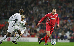 LIVERPOOL, ENGLAND - SUNDAY MARCH 27th 2005: Liverpool Legends' Jan Mølby leaves two Celebrities in his wake during the Tsunami Soccer Aid match at Anfield. (Pic by David Rawcliffe/Propaganda)