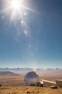 Sun shining down on Mt. John Observatory by Lake Tekapo, South Island, New Zealand