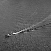 Longtail boatman approches Rai Lay Beach, Krabi Thailand