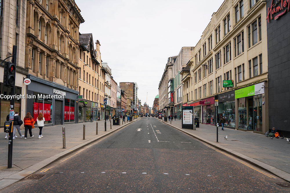 Glasgow, Scotland, UK. 6 Mar 2021. With Scotland remaining under national lockdown during the covid-19 pandemic Glasgow city centre remains a virtual ghost town with few people in the city centre and almost all shops and businesses still closed.  Pic;  Argyle Street is almost empty people and all shops are shuttered.  Iain Masterton/Alamy Live News