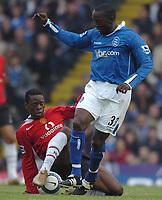 Credit: Back Page Images. Birmingham City v Manchester United, FA Premiership, 16/10/2004. Dwight Yorke (Birmingham City) Louis Saha (Manchester United)