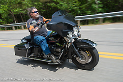 Ride from the Laconia Motorcycle Week headquarters in Weirs Beach, NH to Bentley's Saloon in Arundel, Maine. USA. June 17, 2014.  Photography ©2014 Michael Lichter.