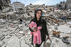 March 28, 2019 - Gaza City, Gaza Strip, Palestinian Territory - Palestinians inspect their house that demolished two days ago by an Israeli airstrike, in Gaza city. Palestinian Minister of Public Works and Housing, Mufid al-Hasayneh, said that recent Israeli airstrikes on the besieged Gaza Strip left 30 residential structures completely destroyed, and at least 500 other others partially damaged  (Credit Image: © Ashraf Amra/APA Images via ZUMA Wire)