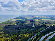 Nederland, Noord-Holland, Hollands Kroon; 07-05-2021; Wieringerwerf, Robbenoordbos, aangelegd na de droogmaking van de Wieringermeer als broekbos. Dijkgatbos op het tweede plan. Rijksweg A7 in de voorgrond.<br /> Wieringerwerf, Robbenoordbos, constructed after the reclamation of the Wieringermeer as a tidal forest. Dijkgatbos on the second plan. Highway A7 in the foreground.<br /> <br /> luchtfoto (toeslag op standaard tarieven);<br /> aerial photo (additional fee required)<br /> copyright © 2021 foto/photo Siebe Swart
