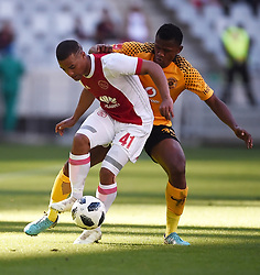 Cape Town-180512   Kaizer Chiefs  defender Siyabonga Ngezana challenges  Fagrie Lakay   of Ajax Cape Town in the last game of the PSL at Cape Town stadium.photographer:Phando Jikelo/African News Agency/ANA