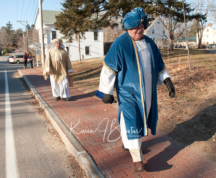 Two of the Three Wise Men Leon Albushies and George Hetherington walk down the street to the Thompson Ames Historical Society where Gilford Community Church presented The Living Nativity on Sunday afternoon.  (Karen Bobotas/for the Laconia Daily Sun)