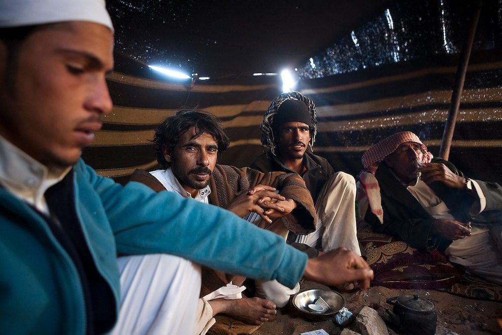 Bedouin brothers relax with their father in his remote home encampment in Wadi Rum, Jordan.