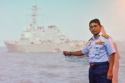 Aug. 21, 2017 - Putrajaya, Malaysia -  Malaysian Maritime Enforcement Agency Director General ZULKIFILI BIN ABU BAKAR shows a photo of the damaged U.S. navy destroyer John S. McCain during a press conference in Putrajaya, Malaysia. Malaysian authorities said Monday assets had been deployed to join the search and rescue operation for 10 missing sailors after the U.S. navy destroyer John S. McCain collided with a merchant vessel near the Strait of Malacca. (Credit Image: © Chong Voon Chung/Xinhua via ZUMA Wire)