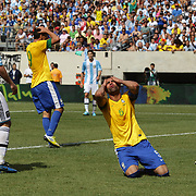 Sandro, Brazil, reacts after putting a header over the bar during the Brazil V Argentina International Football Friendly match at MetLife Stadium, East Rutherford, New Jersey, USA. 9th June 2012. Photo Tim Clayton