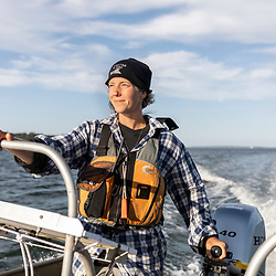 Christina Hassett of the Maine Island Trail Association at the helm of her skiff in Casco Bay, Portland, Maine.