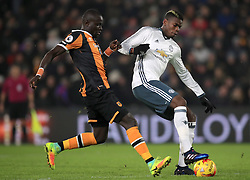 Hull City's Oumar Niasse (left) and Manchester United's Paul Pogba