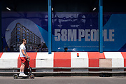 Sign on a hoarding surrounding a redevelopment area on Oxford Street claims that 58 million people will use Tottenham Court Road station in the vicinity in 2020 on 26th June 2020 in London, United Kingdom.