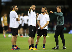 (L-R) Juventus' Andrea Barzagli, Giorgio Chiellini, Claudio Marchisio and fitness coach Andrea Pertusio during a training session held at the National Stadium in Wales ahead of tomorrow's UEFA Champions League Final against Real Madrid