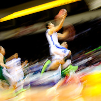 031413  Adron Gardner/Independent<br /> <br /> Laguna Acoma Hawk Anthony Carpio is a blur of motion as he takes to the air for a layup in 2A New Mexico High School Basketball tournament semifinals at the Santa Ana Star Center in Rio Rancho Thursday.