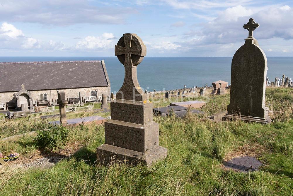 Overlooking the sea is the hilltop churchyard of Saint Tudnos Church on the Great Orme mountain, on 4th October 2021, in Llandudno, Gwynedd, Wales.