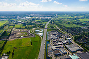 Nederland, Utrecht, Veenendaal, 29-05-2019; Rijksweg A12 met afslag naar bedrijventerrrein.<br /> Motorway A12.<br /> luchtfoto (toeslag op standard tarieven);<br /> aerial photo (additional fee required);<br /> copyright foto/photo Siebe Swart