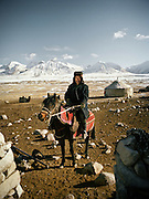 Ooroon Boi, one of the Khan's son's opium addict, on his way to gathering yaks from his herd. Qyzyl Qorum campment, Abdul Rashid Khan's camp (leader of the Afghan Kyrgyz). .Winter expedition through the Wakhan Corridor and into the Afghan Pamir mountains, to document the life of the Afghan Kyrgyz tribe. January/February 2008. Afghanistan