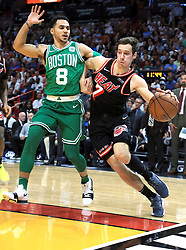 November 22, 2017 - Miami, FL, USA - The Miami Heat's Goran Dragic drives as the Boston Celtics' Shane Larkin (8) defends in the second quarter at the AmericanAirlines Arena in Miami on Wednesday, Nov. 22, 2017. The Heat won, 104-98. (Credit Image: © Al Diaz/TNS via ZUMA Wire)