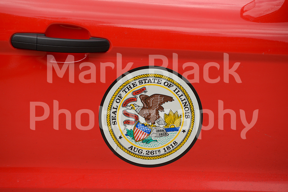 The Seal of the State of Illinois on a vehicle in Chicago.<br /> Photo by Mark Black