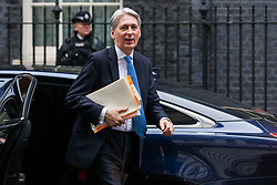 London, UK. 6th December, 2018. Philip Hammond MP, Chancellor of the Exchequer, arrives at 10 Downing Street for a special Cabinet meeting called to discuss the latest developments regarding Brexit.