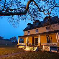 The Sandy Hook History House at night.  The history house is a fully restored Officers home part of Officers Row in Fort Hancock Sandy Hook New Jersey