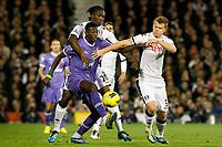 Football - Premier League - Fulham vs. Tottenham Hotspur<br /> <br /> Fulham's Dickson Etuhu and John Arne Riise and Tottenham Hotspur's Emmanuel Adebayor battle for the ball at Craven Cottage