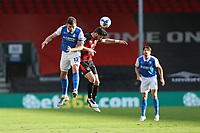 Football - 2020 / 2021 Sky Bet Championship - AFC Bournemouth vs. Birmingham City - The Vitality Stadium<br /> <br /> Harlee Dean of Birmingham City out jumps Bournemouth's Shane Long to win a header during the Championship match at the Vitality Stadium (Dean Court) Bournemouth <br /> <br /> COLORSPORT/SHAUN BOGGUST