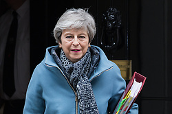 March 27, 2019 - London, England, United Kingdom - British Prime Minister THERESA MAY  leaves 10 Downing Street in central London for the weekly PMQ session in the House of Commons. Today, MPs will hold a series of indicative votes on alternative Brexit plans following a government defeat in the Commons as parliamentarians took control of the order paper. (Credit Image: © Wiktor Szymanowicz/NurPhoto via ZUMA Press)