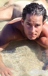 naked man in shallow water
