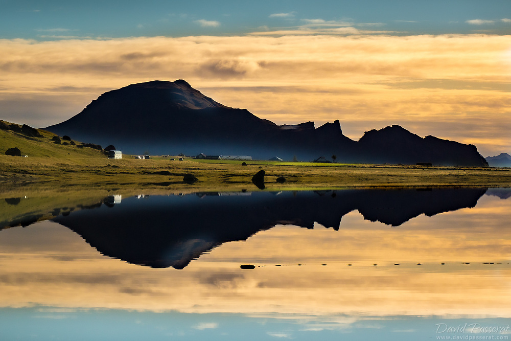 reflected mountain scenery over a lake in Iceland