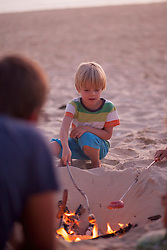 Boy with his family enjoying camping on the beach, Lit-et-Mixe, Aquitaine, France
