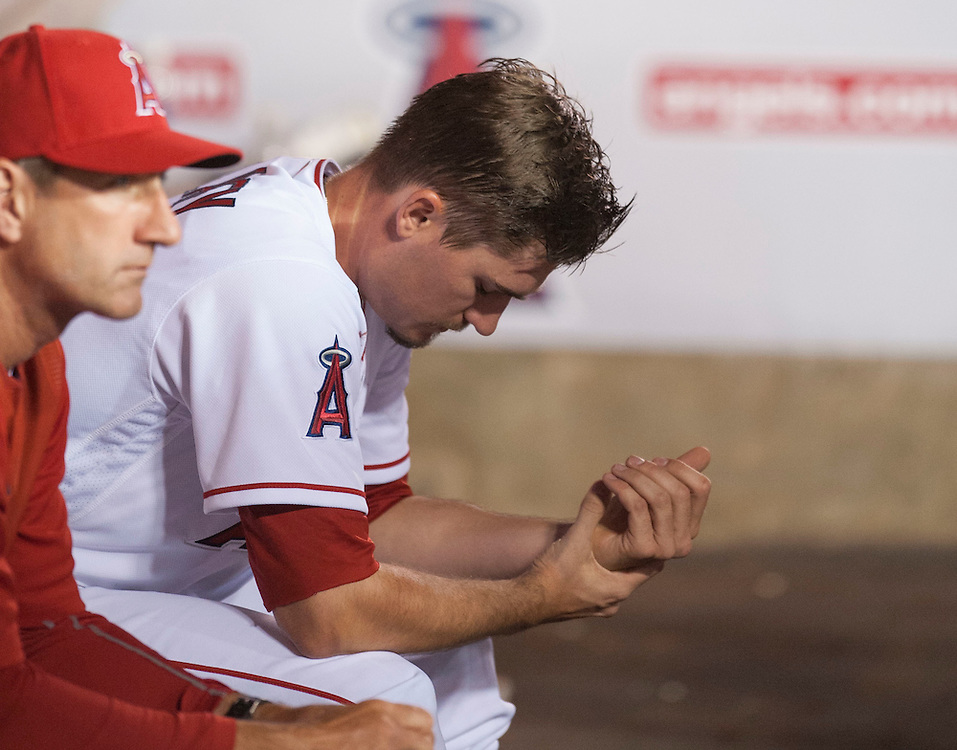 Angels starting pitcher Andrew Heaney sits in the dugout next to pitching coach Charles Nagy after a four-run third inning by the Chicago Cubs during their game at Angel Stadium Tuesday.<br /> <br /> ///ADDITIONAL INFO:   <br /> <br /> angels.0406.kjs  ---  Photo by KEVIN SULLIVAN / Orange County Register  --  4/5/16<br /> <br /> The Los Angeles Angels take on the Chicago Cubs Tuesday at Angel Stadium.<br /> <br /> <br />  4/5/16