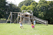 Charlotte, 6, Edward, 12 and Joseph, 12 in the children's paddock with zip line at Hares Farm CREDIT: Vanessa Berberian for The Wall Street Journal<br /> UKFARM-Hares Farm