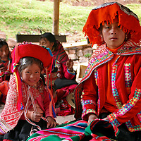 Americas, South America, Peru, Cusco. Learing the skill of weaving is a family tradition at Awana Kancha.