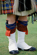Traditional Scottish kilt and sporran with dirk dagger in sock at the Braemar Royal Highland Gathering, the Braemar Games in Scotland