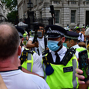 Loud mouth protestors swearing at police at the front of 10 Downing street on 14th June 2021, London, UK.