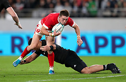 Wales' Josh Adams (left) is challenged by New Zealand's Atunaisa Moli during the 2019 Rugby World Cup bronze final match at Tokyo Stadium.