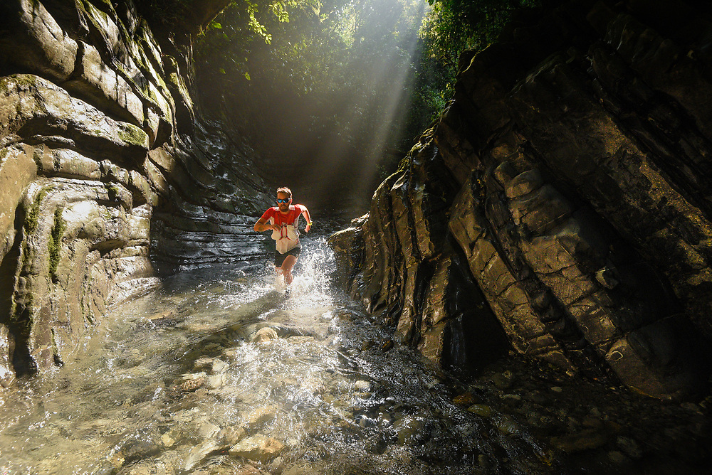 Trail runner Sebas Azcarate exploring a canyon at Los Limones in Xicotepec, Puebla.<br /> Client/Project: Personal project