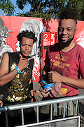 """August 27, 2016- Brooklyn, New York-United States: (L-R) Visual Artists Miguel Ovalle and Coby Kennedy attend and install their artwork during the 2016 AfroPunk Brooklyn Concert Series held at Commodore Barry Park on August 27, 2016 in Brooklyn, New York City. Described by some as """"the most multicultural festival in the US,"""" which includes an eclectic line-up and an audience as diverse as the acts they come to see. (Photo by Terrence Jennings/terrencejennings.com)"""