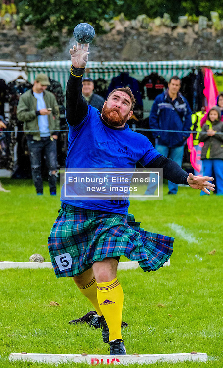 Peebles, Scotland UK  3rd September 2016. Peebles Highland Games, the biggest 'highland' games in the Scottish  Borders took place in Peebles on September 3rd 2016 featuring pipe band contests, highland dancing competitions, haggis hurling, hammer throwing, stone throwing and other traditional events.<br /> <br /> Pictured:  a competitor in the shot put competition<br /> <br /> (c) Andrew Wilson   Edinburgh Elite media